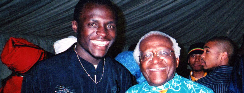 Patrick Kabanda with Archbishop Desmond Tutu
